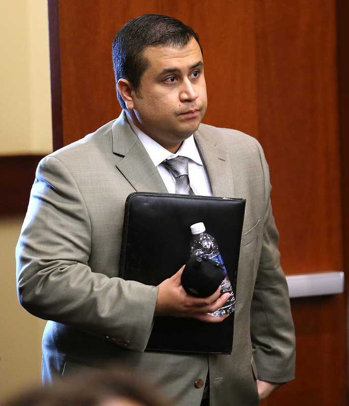 George Zimmerman arrives in the courtroom for the 21st day of his trial in Seminole circuit court, in Sanford, Fla., Tuesday, July 9, 2013. Zimmerman is charged with 2nd-degree murder in the fatal shooting of Trayvon Martin, an unarmed teen, in 2012. (Joe Burbank/Orlando Sentinel/POOL)