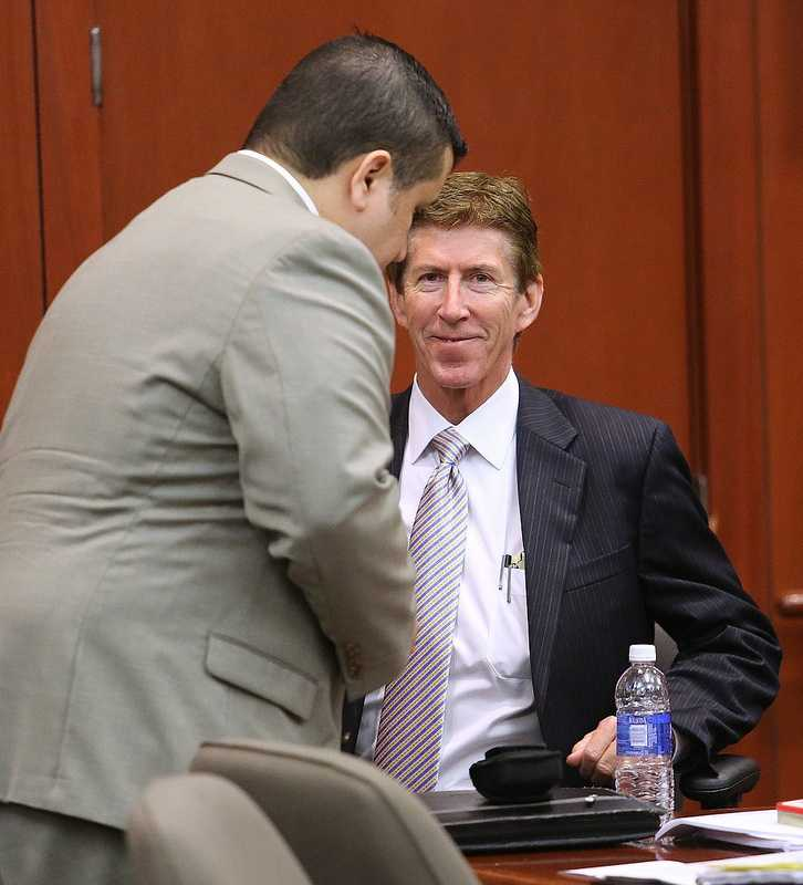 George Zimmerman arrives in the courtroom, with defense counsel Mark O'Mara, for the 21st day of his trial in Seminole circuit court, in Sanford, Fla., Tuesday, July 9, 2013. Zimmerman is charged with 2nd-degree murder in the fatal shooting of Trayvon Martin, an unarmed teen, in 2012. (Joe Burbank/Orlando Sentinel/POOL)