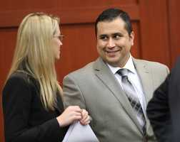 George Zimmerman chats with Brandy Dixon an assistant from his defense team, during his trial in Seminole circuit court, in Sanford, Fla., Tuesday, July 9, 2013. Zimmerman is charged with 2nd-degree murder in the fatal shooting of Trayvon Martin, an unarmed teen, in 2012. (Joe Burbank/Orlando Sentinel/POOL)