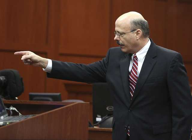 Assistant state attorney Bernie de la Rionda points to the defendent while presenting the state's closing arguments against George Zimmerman during his trial in Seminole circuit court in Sanford, Fla. Thursday, July 11, 2013. Zimmerman has been charged with second-degree murder for the 2012 shooting death of Trayvon Martin. (Gary W. Green/Orlando Sentinel)