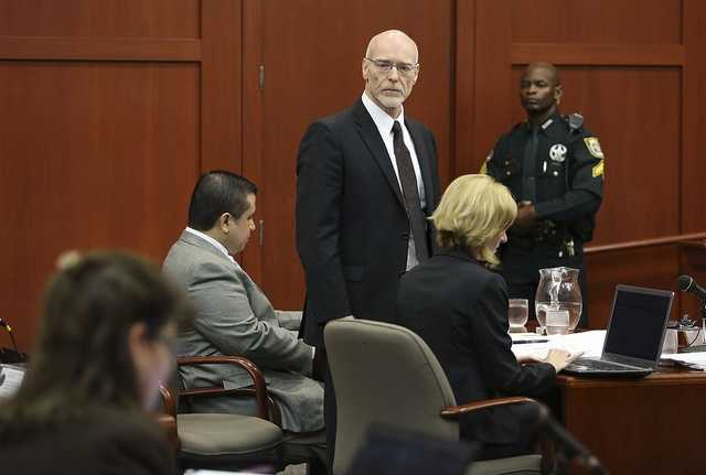 Defense attorney Don West glares back at State Attorney Angela Corey after the state entered a request that child abuse charges be allowed against George Zimmerman during his trial in Seminole circuit court in Sanford, Fla. Thursday, July 11, 2013. Zimmerman has been charged with second-degree murder for the 2012 shooting death of Trayvon Martin. (Gary W. Green/Orlando Sentinel)