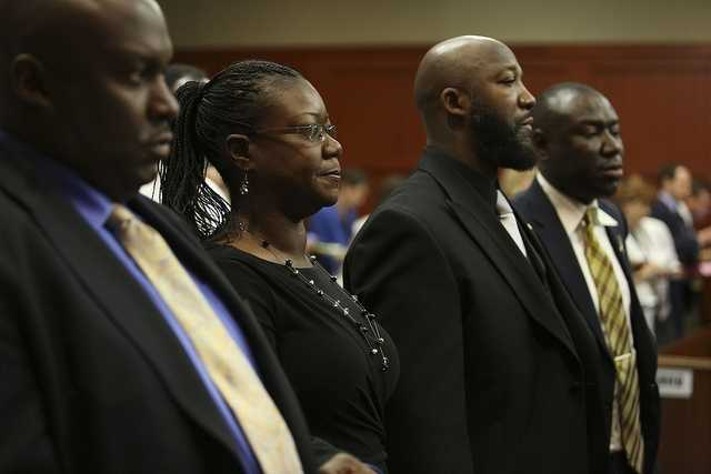 Flanked by attorneys Daryl Parks, far left, and Benjamin Crump, far right, Trayvon Martin's parents Sabrina Fulton and Tracy Martin, stand during closing arguments in George Zimmerman's trial in Seminole circuit court in Sanford, Fla. Thursday, July 11, 2013. Zimmerman has been charged with second-degree murder for the 2012 shooting death of Trayvon Martin. (Gary W. Green/Orlando Sentinel)