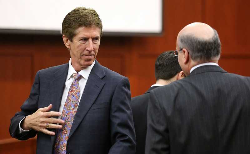 Defense counsel Mark O'Mara talks to prosecutor Bernie de la Rionda on the 24th day of the George Zimmerman trial at the Seminole County Criminal Justice Center, in Sanford, Fla., Friday, July 12, 2013. Zimmerman is charged with 2nd-degree murder in the fatal shooting of Trayvon Martin, an unarmed teen, in 2012. (Joe Burbank/Orlando Sentinel/POOL)