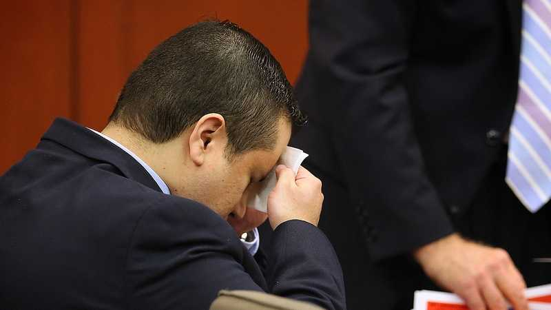 George Zimmerman wipes perspiration from his face after arriving in the courtroom on the 24th day of the his trial at the Seminole County Criminal Justice Center, in Sanford, Fla., Friday, July 12, 2013. Zimmerman is charged with 2nd-degree murder in the fatal shooting of Trayvon Martin, an unarmed teen, in 2012. (Joe Burbank/Orlando Sentinel/POOL)