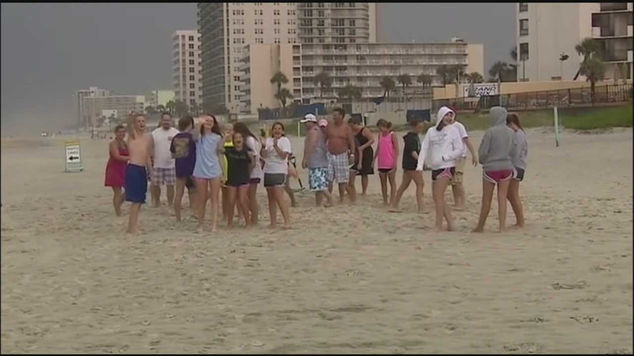 A woman whose car was stuck in some soft sand along Daytona Beach was helped by a Christian youth group's muscle power, and perhaps a higher power.