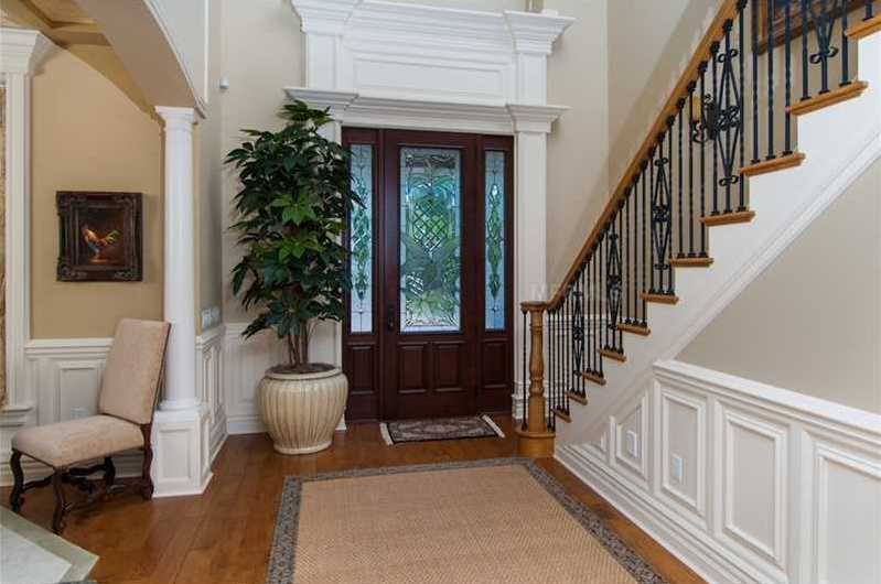 Classic foyer offers a warm greeting to the luxury property.