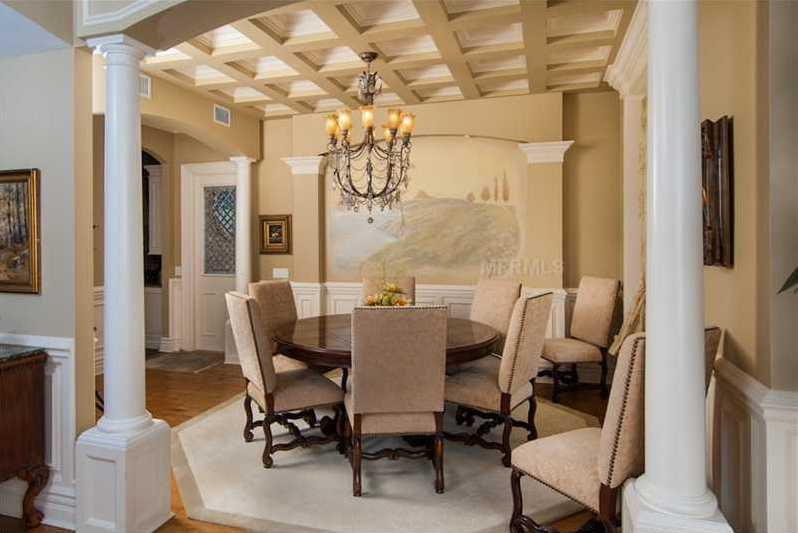 Beautiful dining room features an elegant ceiling.