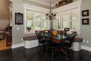 Kitchen nook is complete with comfortable bench seating.