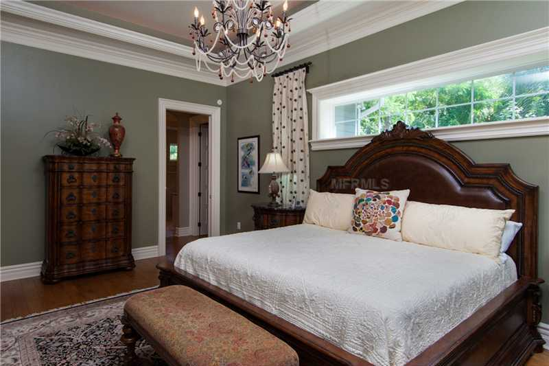 Master bedroom suite is quite large and offers a touch of glam with the custom chandelier.