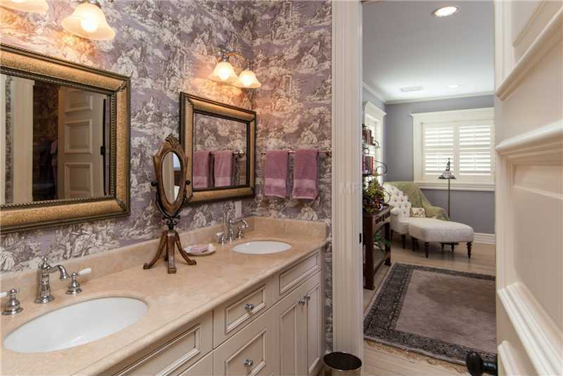 Long dual sink and vanity in this private bathroom.
