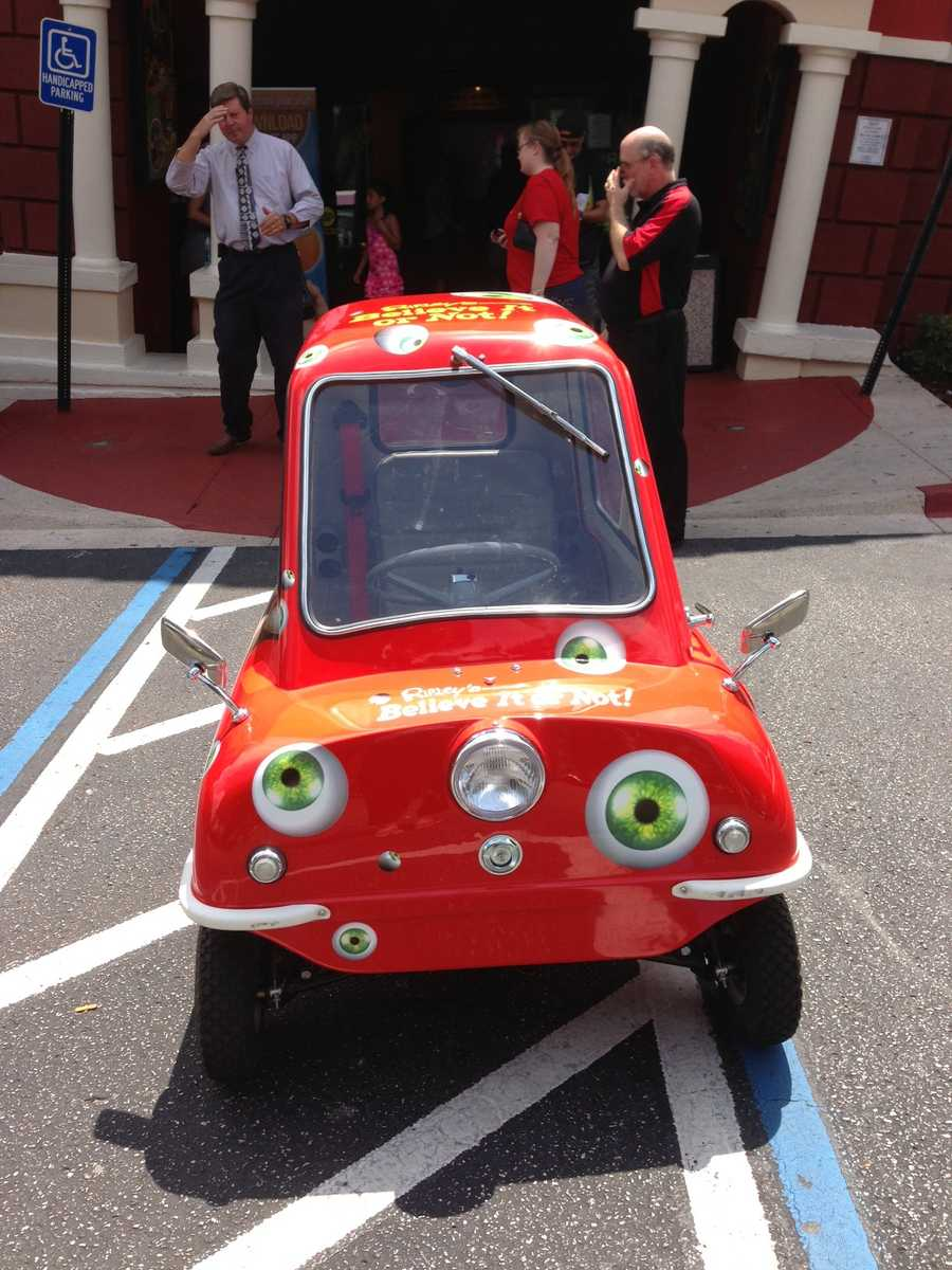 WESH 2 reporter Dave McDaniel got to test drive the smallest car ever to go into production Friday. McDaniel is 6 feet 5 inches tall.