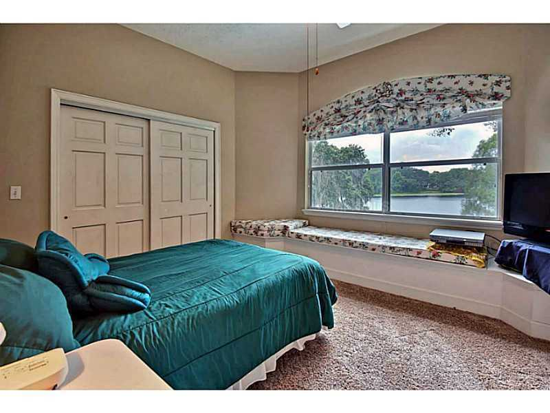 This bedroom features a marvelous view of the lake that you can enjoy on the built in day-bed.