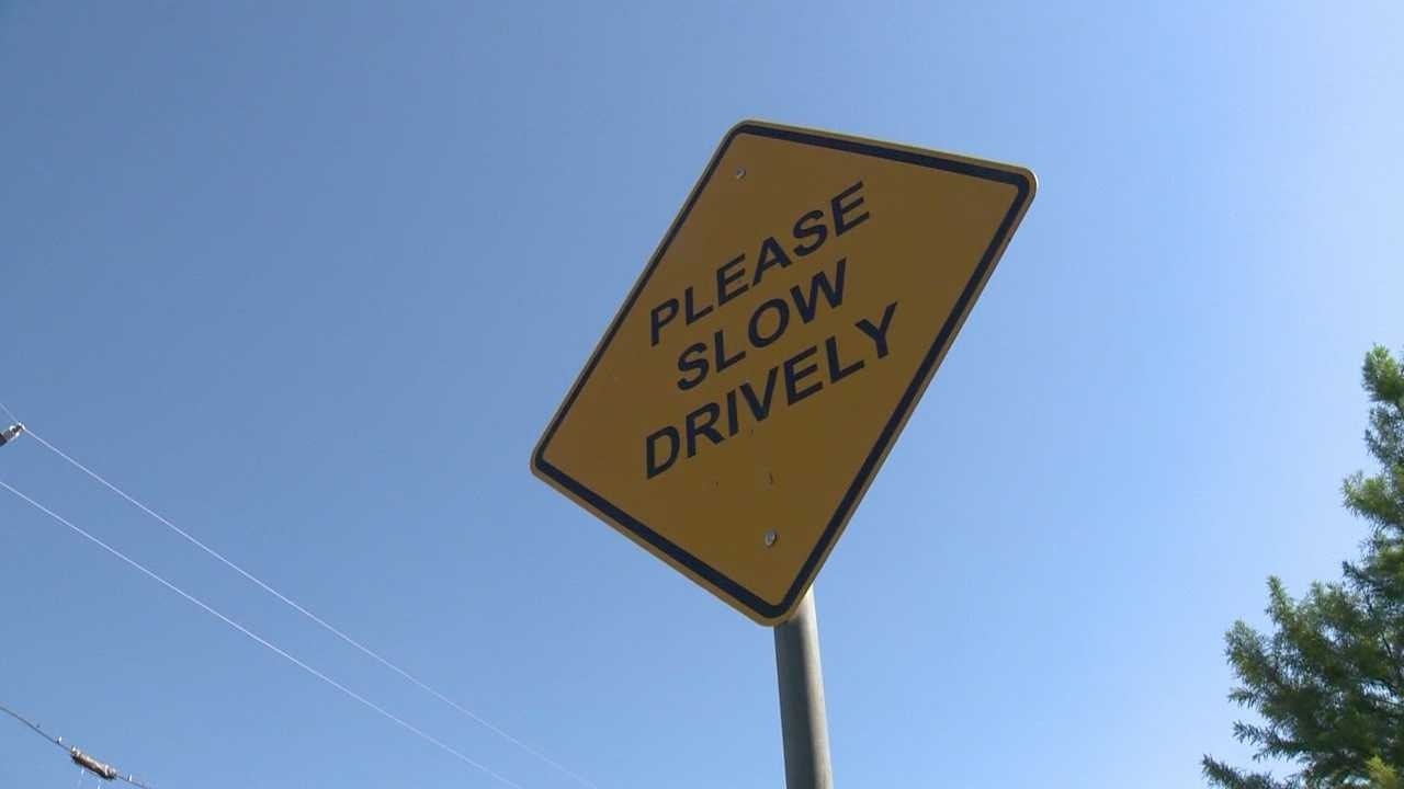 "A sign on private property that reads ""Please Slow Drively"" has gained national attention."