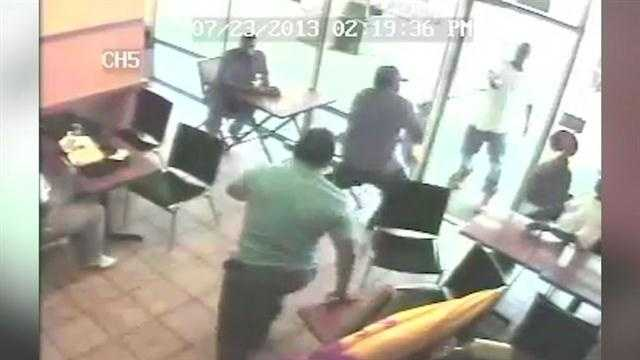 Surveillance cameras capture an armed robbery of an Orlando restaurant.