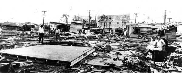 1926: Miami residents look through rubble after a hurricane.