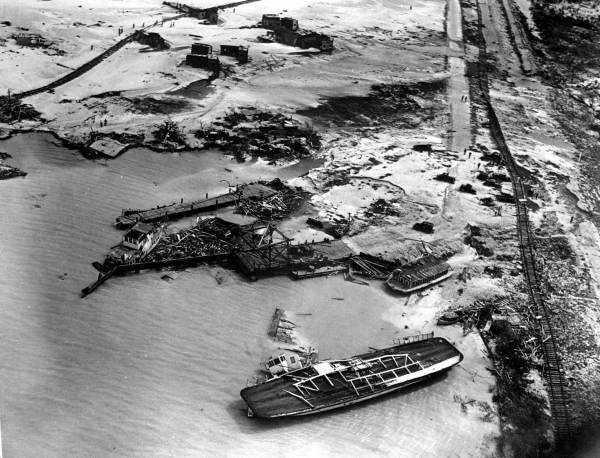 1935: An overhead shot of the damage left behind during a hurricane in The Keys.  The train track was moved by incoming water.