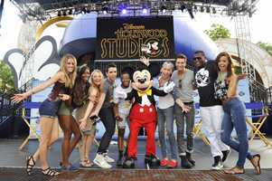 "Nine of the ""American Idol"" finalists from the most recent season of the TV show were celebrated with a Hollywood-style motorcade in Disney's Hollywood Studios theme park Wednesday."