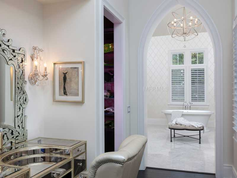 The vanity area is next to the huge walk-in closet and beautiful master bath. The bathroom features a stand alone Roman Tub.