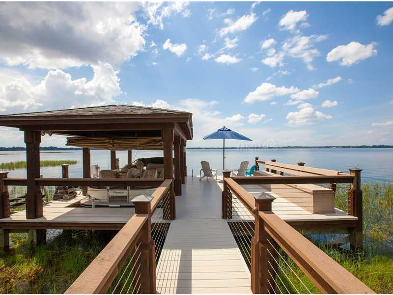 The gracious private dock offers plenty of lounge space so you can relax on Lake Butler.