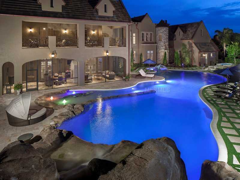 At nighttime, the pool is illuminated by spectacular lighting offering a serene view from both the downstairs, screened-in patio and second floor balconies.