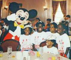 The Gaithers also posed with Mickey Mouse.