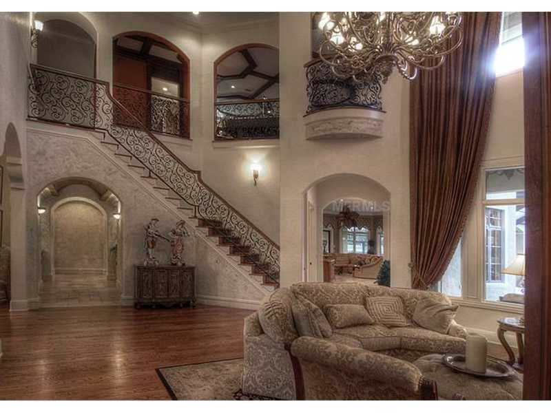 Grand foyer has a stunning amount of detail along the staircase and balcony.