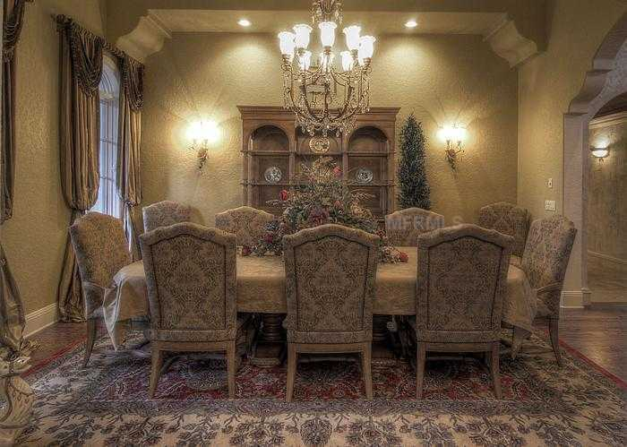 Formal dining room continues the theme of elegant Tuscan decor.