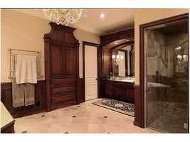 Master bathroom provides a luxurious experience from the custom vanity, to the generous shower and stand alone spa tub.