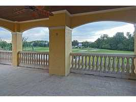 Enjoy views of the golf course as you dine and entertain under this covered patio space. Not featured in this tour, is the three-car garage and guest home that comes with property. But for more information, visit Realtor.com.