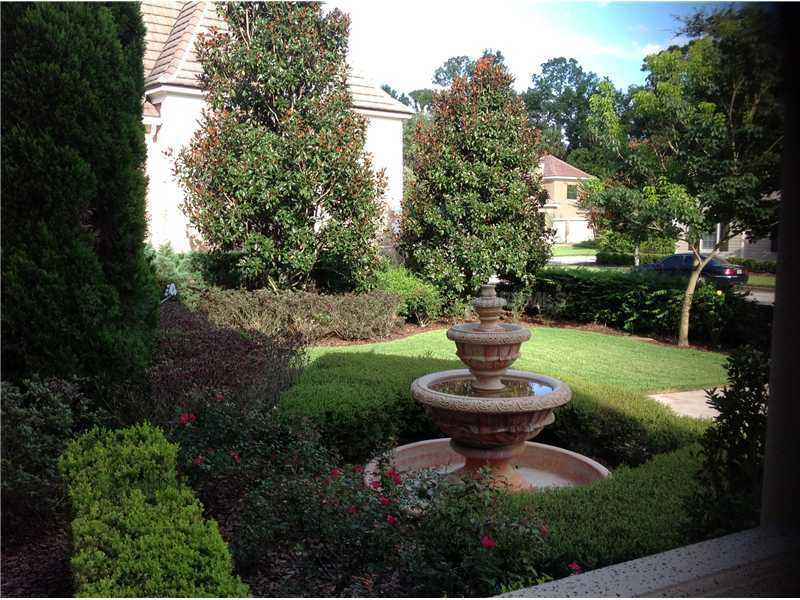 Meticulous and lush landscaping surround the exterior of the property.