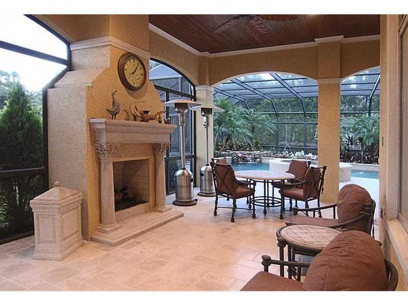 An additional screened in pool area is included on the back end of this mansion. It is fully equipped with an outdoor fireplace and heating lamps, to add comfort and create ambiance.