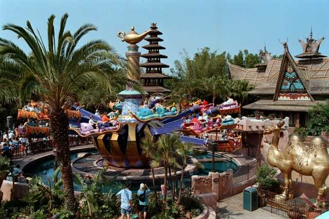 The Magic Carpets of Aladdin: Take off on a magical ride above a bustling bazaar aboard an enchanted carpet that you control. Climb aboard a colorful, four-passenger vehicle and take off into the air as the strings of Middle Eastern music play overhead. Rotate around a giant genie bottle and magic lamp—bobbing up and down, forward and back—as the lush flora and weathered walls of the bazaar whirl by below.
