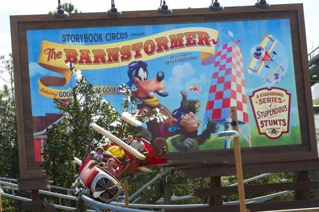 The Barnstormer Featuring The Great Goofini: Back when the circus arrived in town and pitched a tent in what is now known as New Fantasyland, Goofy spotted an abandoned barn and decided it would be the perfect staging area for an amazing new daredevil flying act with great appeal for families. Today, you're invited to board one of Goofy's homemade stunt planes and take part in his astounding aerial stunt show: The Barnstormer featuring Goofy as The Great Goofini.