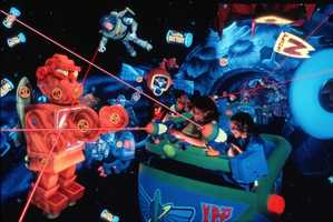 Buzz Lightyear's Space Ranger Spin: Evil Emperor Zurg is stealing batteries from helpless toys to power a new weapon of destruction. As a Junior Space Ranger, it's up to you to maneuver an XP-37 star cruiser through the neon-lit Gamma Quadrant and fire lasers from an onboard cannon to stop him and score points.