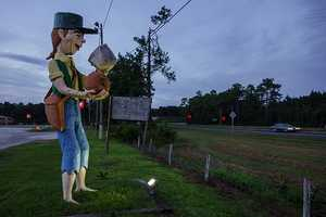 Johnny Donutseed in Lloyd: This 10 to 11 foot statue can be found just south of Interstate 10 on State Road 59. He stands in front of the BP gas station off the highway and carries a cup of coffee and donut.