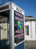 World's Smallest Police Station in Carabelle: In the early 1960's, Carrabelle's police phone was located in a call box that was bolted to a building at the corner of Highway 98 and Tallahassee Street. On March 10, 1963 the phone booth was moved to its current location on Highway 98. There were a couple of reason for doing so - to protect police officers from the elements, as well as curtail the illegal calls. Unfortunately, the illegal phone calls continued to be a problem and eventually the dial was removed from the phone.