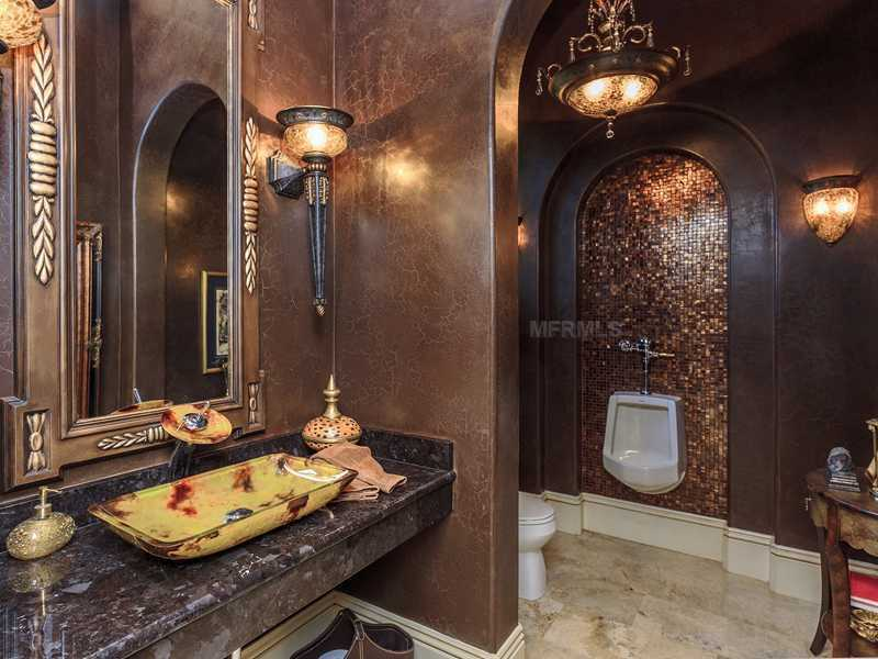 The master bathroom features a urinal that's both fancy and functional.