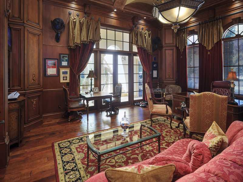 The library boasts hand carved paneling with two built-in humidors.