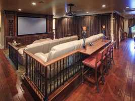 The second floor also boasts a 29- by 25-foot theater room that seats 14 people.