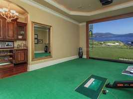The home also boasts a golf simulator.
