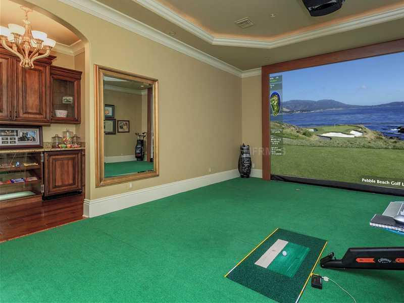 The home also boasts a golf simulator.