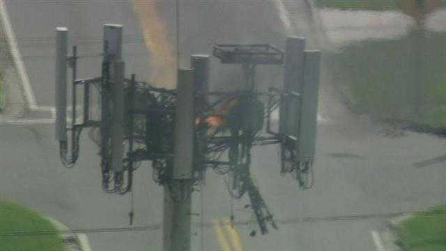 Seminole County authorities worked to get five cellphone tower workers off a tower that caught fire on Wednesday.