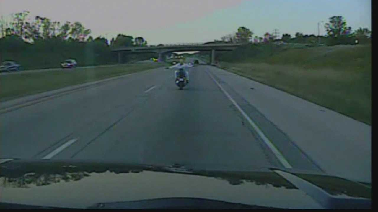 Police dash cam video from Bayside shows a woman driving a motorcycle on Interstate 43 with no hands... and no shirt!