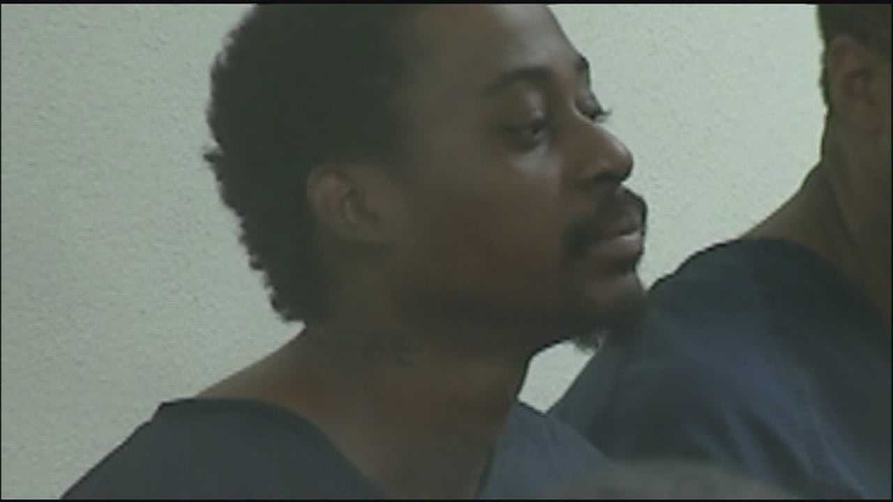 A man with a history of violence against women is accused of raping woman in front of her child.