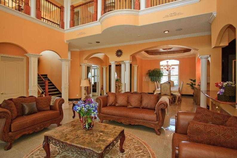 The first floor boasts an expansive open layout, with the balcony overlooking the formal living space.