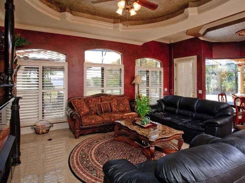 There is also access from the family room to the covered patio, which has a large pool and Jacuzzi.