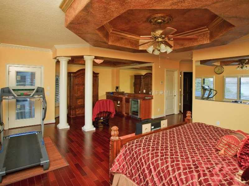The master bedroom has an elevator just outside the door, breakfast bar with built-in coffee maker, an entrance to the balcony and cherry hardwood floors.