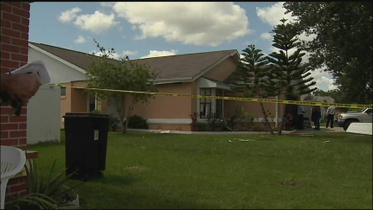 Officials are investigating an explosion at a home in Buenaventura Lakes that blew out the garage door and windows.