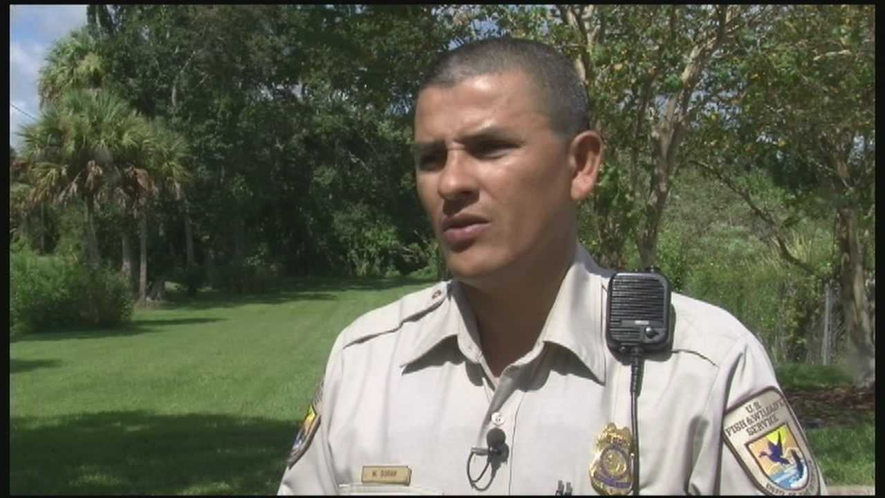 A Fish and Wildlife officer has received one of the highest honors for crawling into a burning car and rescuing a woman.