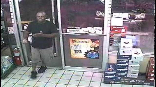 Orlando police said they are looking for a man who threatened a convenience store clerk and then stole two cartons of cigarettes on Tuesday.